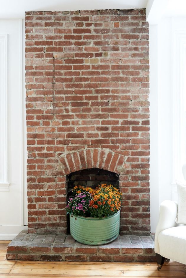 Fireplace Decorating Ideas With Large Planter With Colorful Flowers