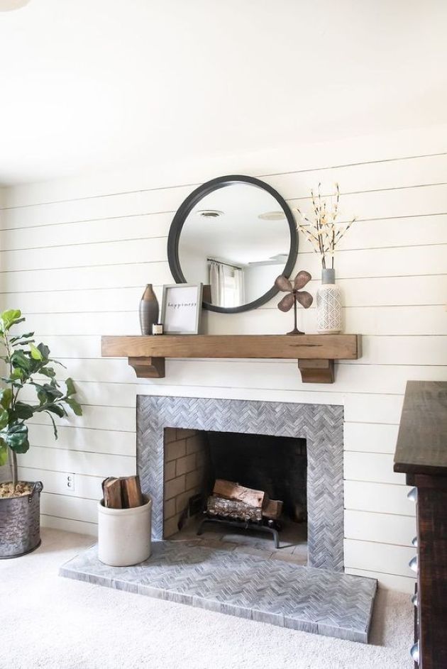 Fireplace With Grey Marble Tiles Clad In A Chevron Pattern