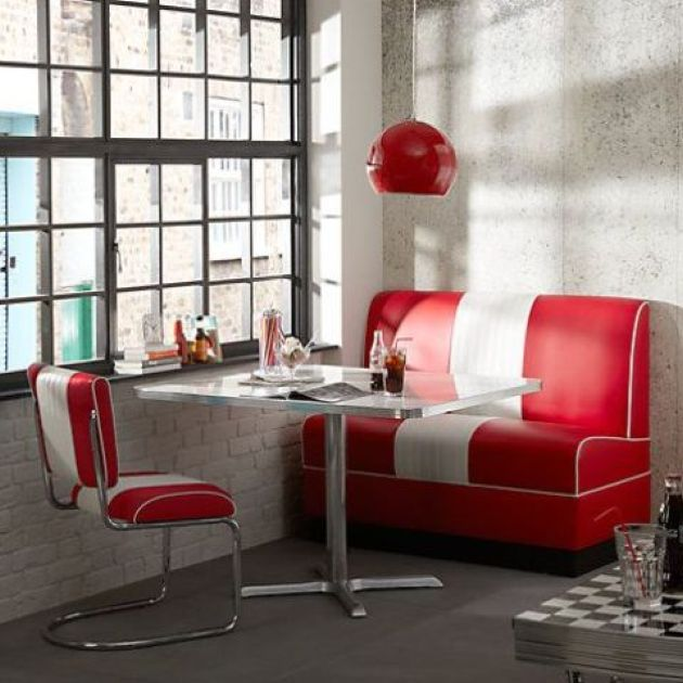 Fun Industrial Retro Dining Space With A Striped Sofa And Chair