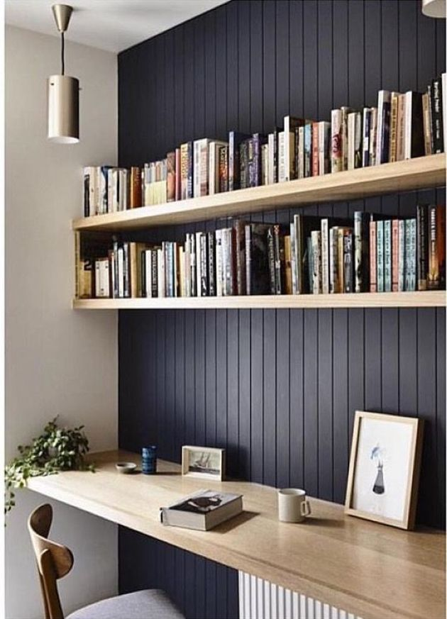 Home Office With Black Wall And Light-Colored Wooden Floating Shelves