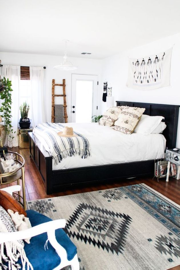 Light-Filled Eclectic Bedroom With A Dark Bed
