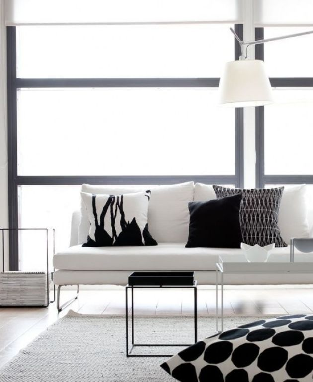 Minimalist Black And White Living Room With A Stylish White Couch