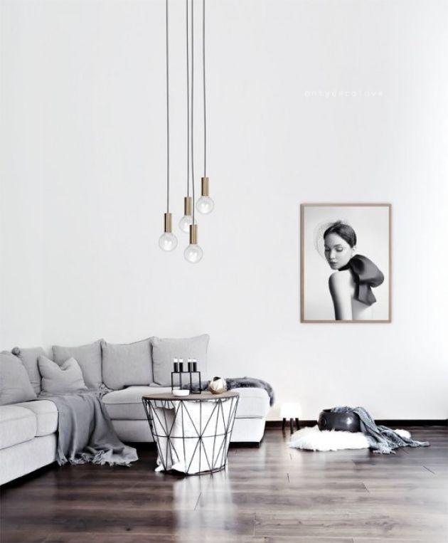 Minimalist Living Room With A Grey Sofa And An Artwork