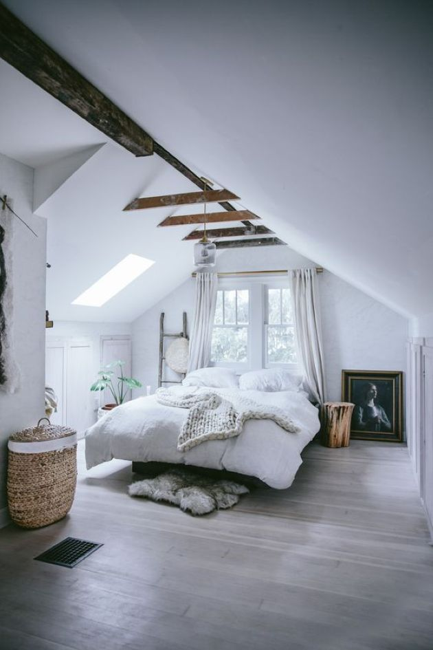 Modern Attic Bedroom With Much Light Plus Dark Stained Beams