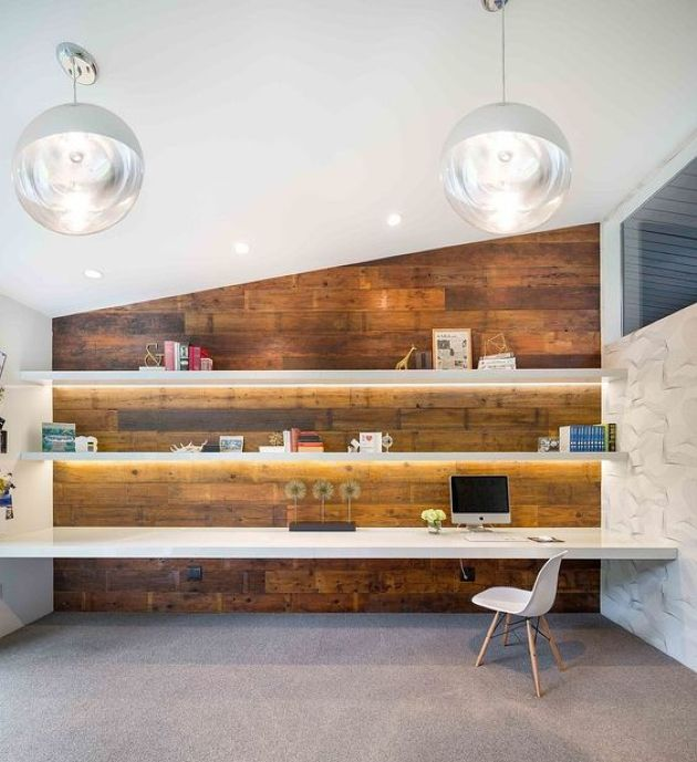 Modern Home Office With Lit Up Floating Shelves And A Matching Desk