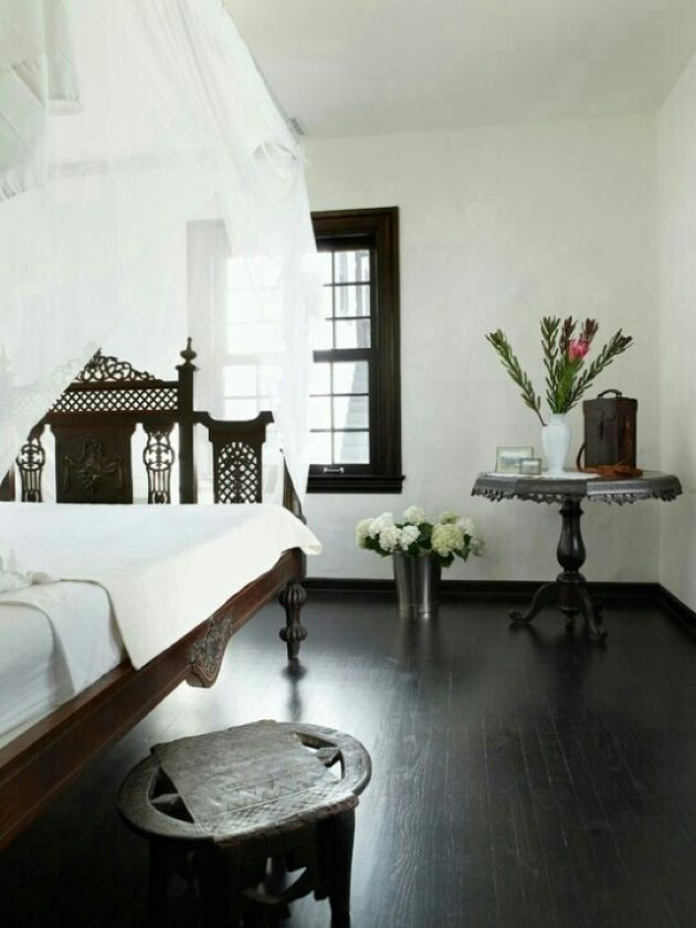 Monochromatic Moroccan Bedroom With A Carved Wooden Bed