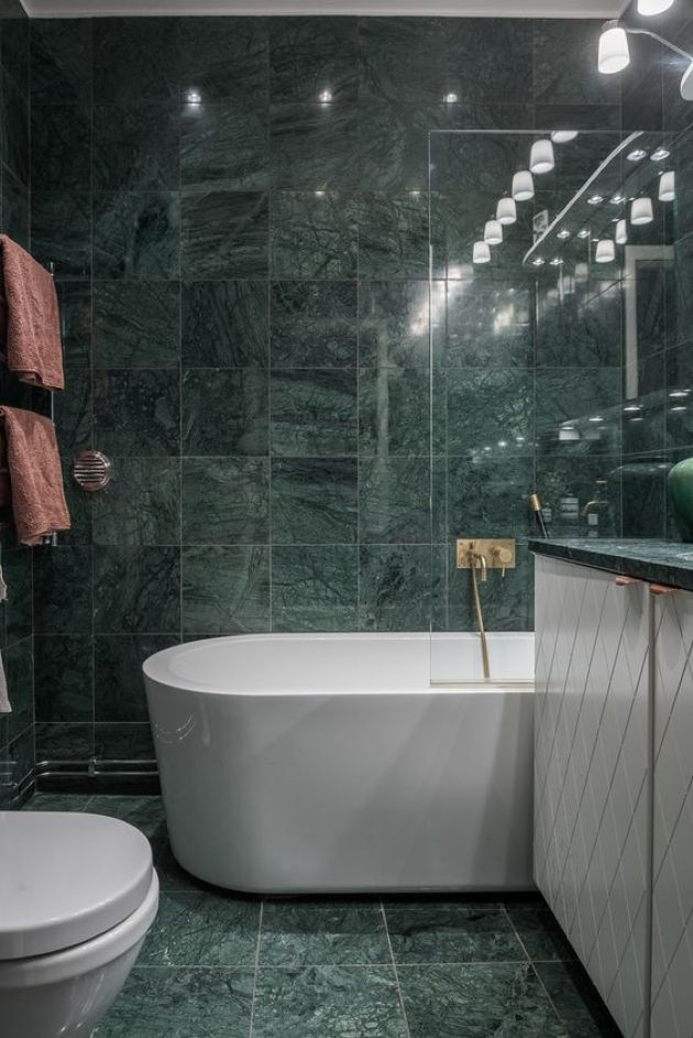 Moody Bathroom With Green Marble Tiles