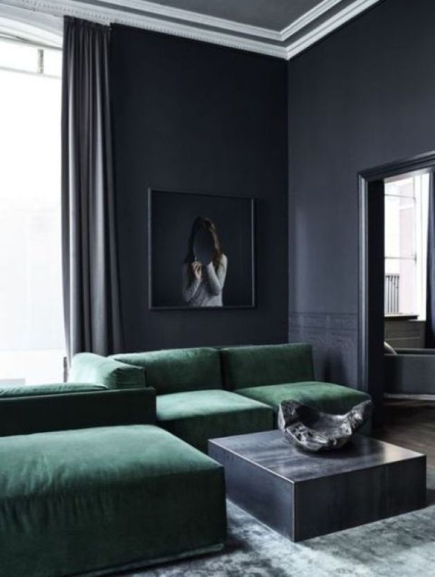 Moody Graphite Grey Minimalist Living Room With A Small Coffee Tables