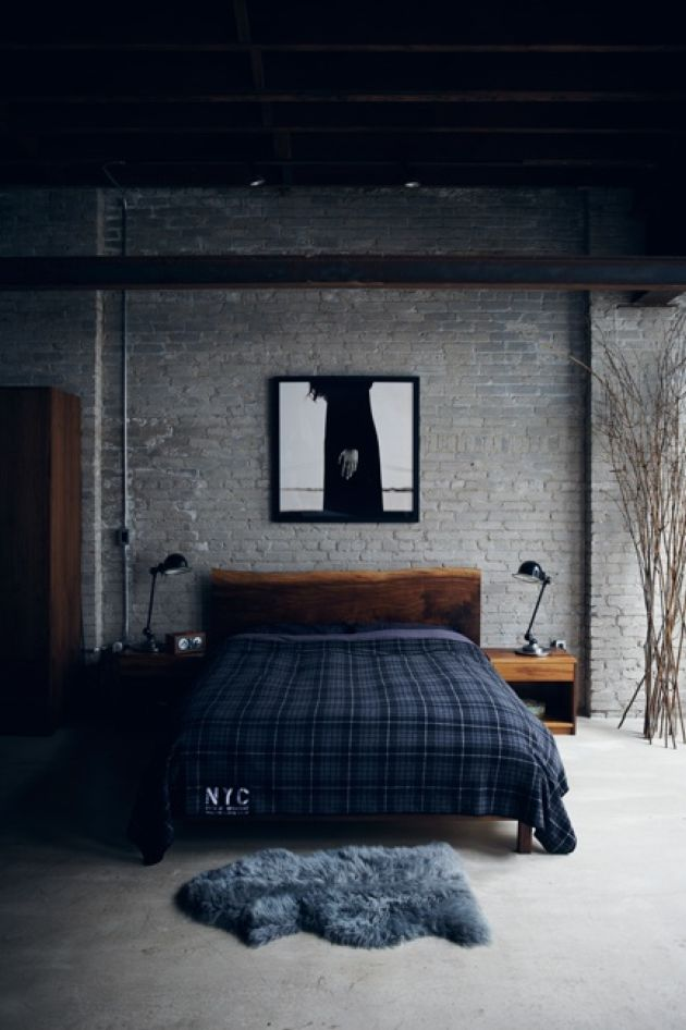 Moody Masculine Bedroom With A Grey Brick Statement Wall