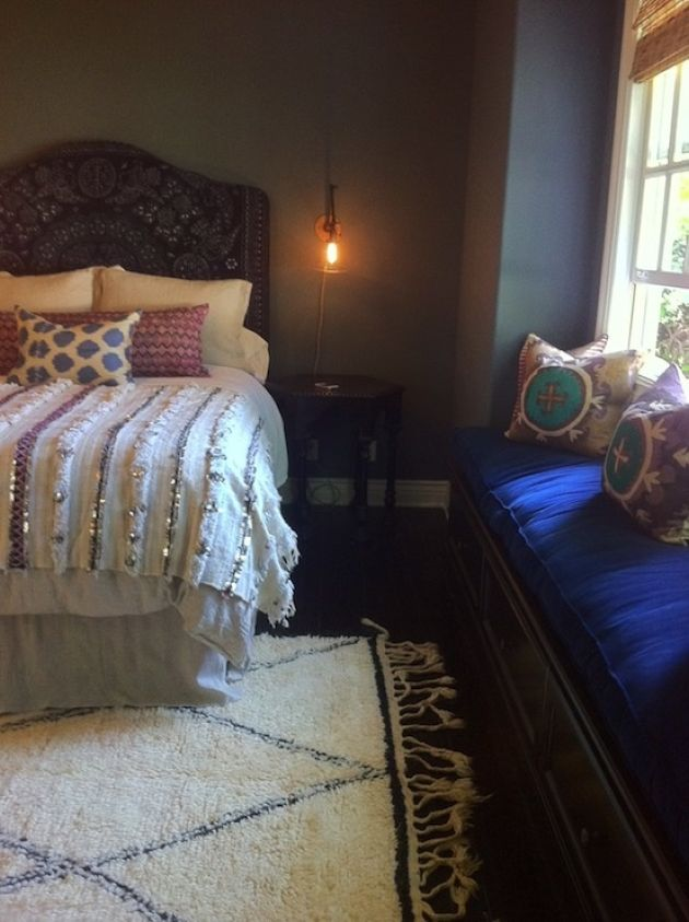 Moody Moroccan Bedroom With An Ornate Headboard Bed