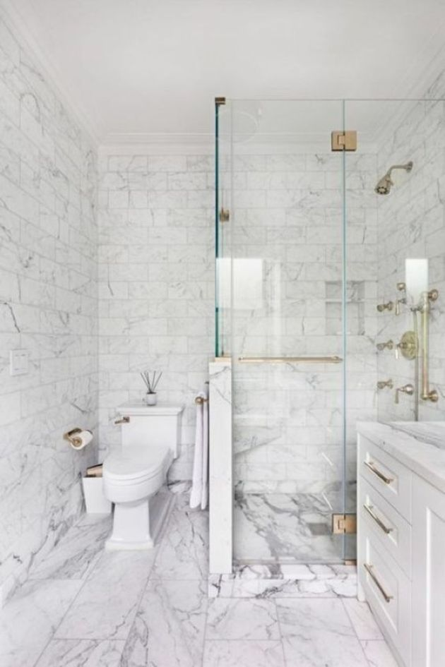 Neutral Bathroom With White Marble Tiles Of Various Sizes