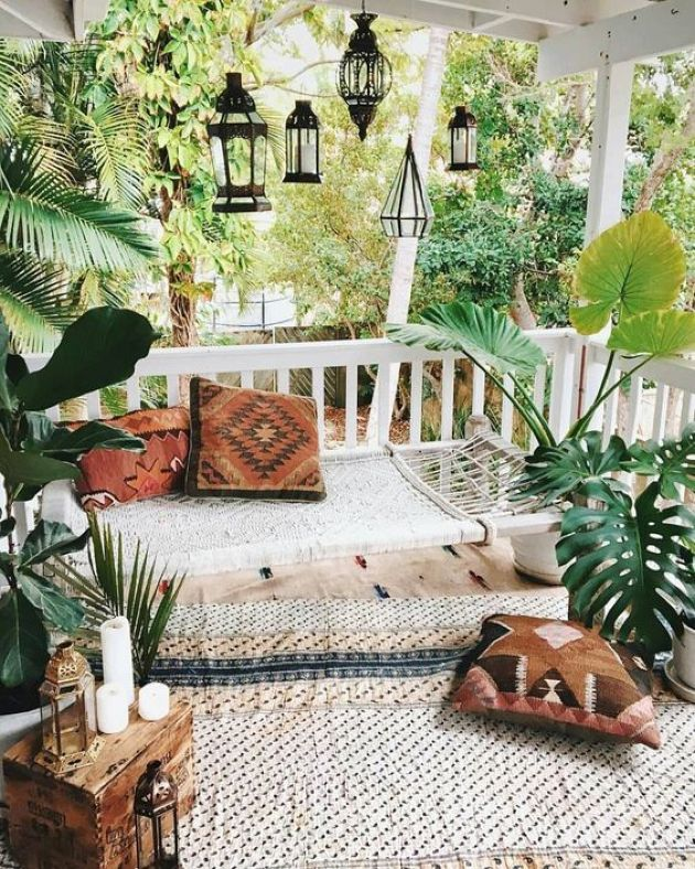 Neutral Boho Patio With A Woven Hammock And Printed Rugs