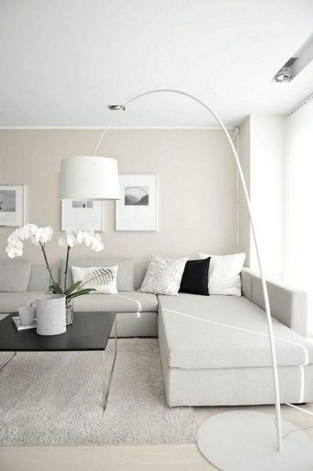 Neutral Minimalist Living Room With An Off-White Sectional Sofa
