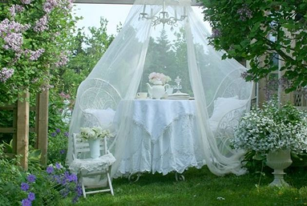Outdoor Dining Space With Chairs And A Table Plus A Mosquito Net