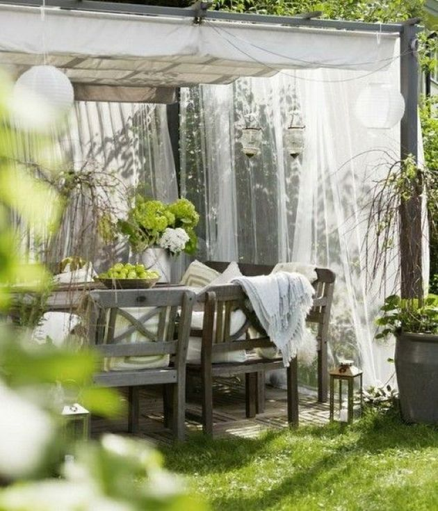 Outdoor Rustic Dining Space With Mosquito Net Curtains