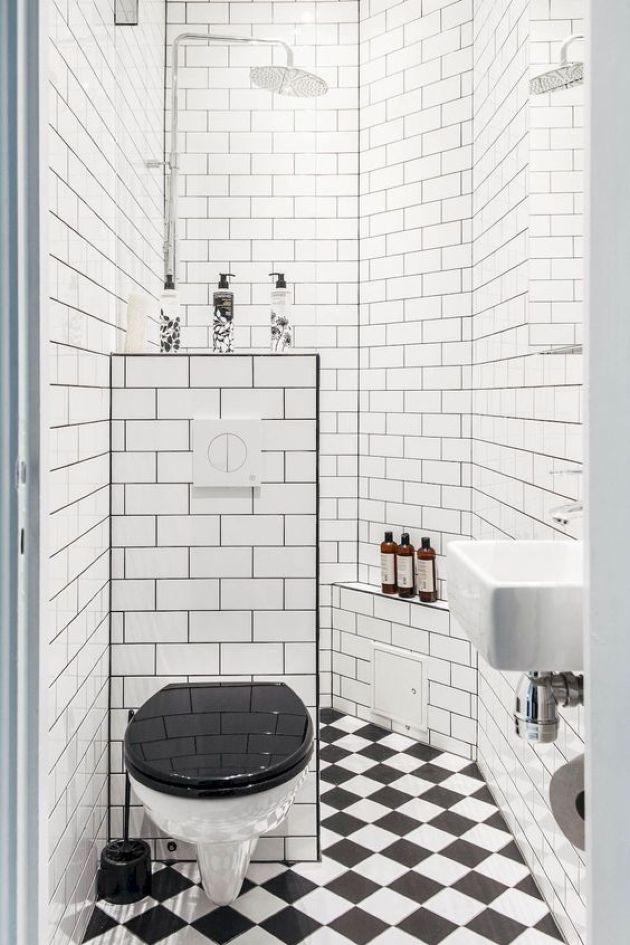 Retro-Inspired Black And White Small Bathroom With A Shower Space