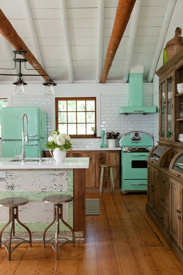 Retro Kitchen With Mint Fridge, A Cooker And A Hood