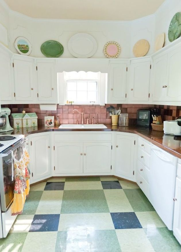 Retro Kitchen With Pink Tile Backsplash And Bold Dishes