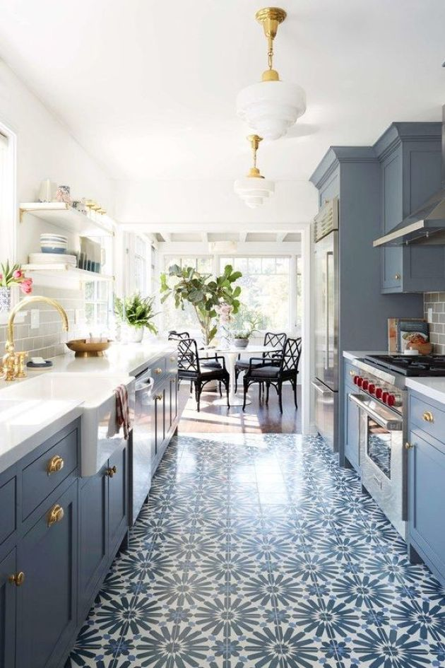 Retro Kitchen With Pretty Patterned Tile Floor Matching The Cabinets
