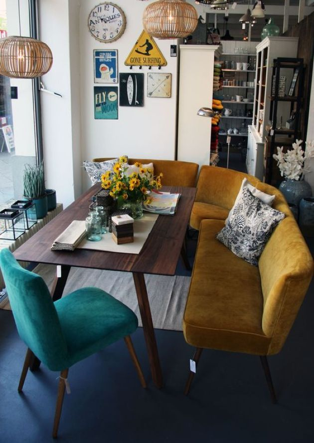 Retro Living Room With Curved Mustard Bench And A Teal Chair