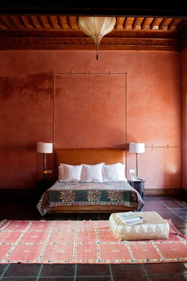 Rust-Colored And Red Moroccan Living Room With A Leather Bed