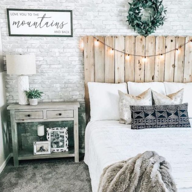 Rustic Bedroom With A White Fake Brick Wall