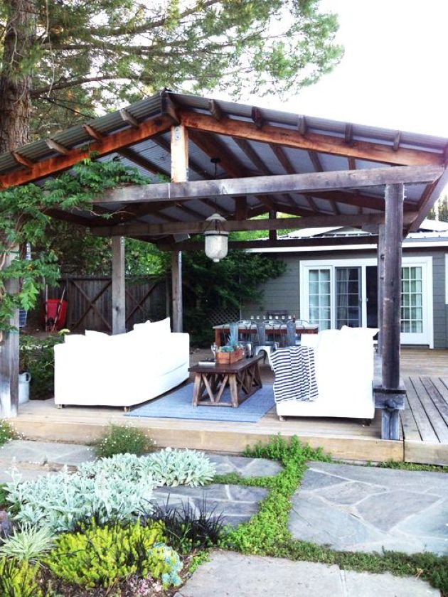 Rustic Patio With White Sofas Plus A Dining Space
