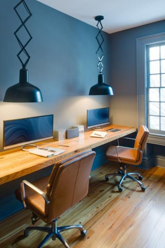 Shared Workspace With A Floating Desk And A Couple Of Leather Chairs