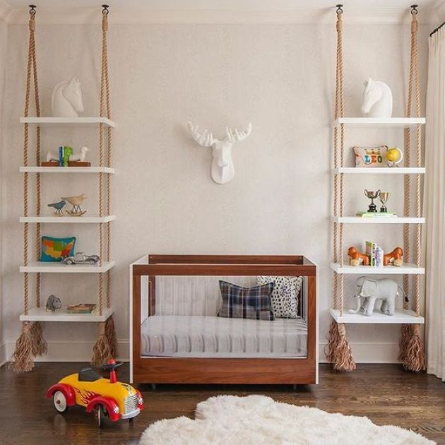 Shelving Units Hanging On Ropes With Tassels On Both Sides Of The Crib