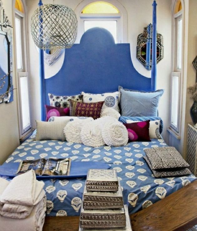 Small Blue Moroccan-Inspired Bedroom With An Ornate Bed