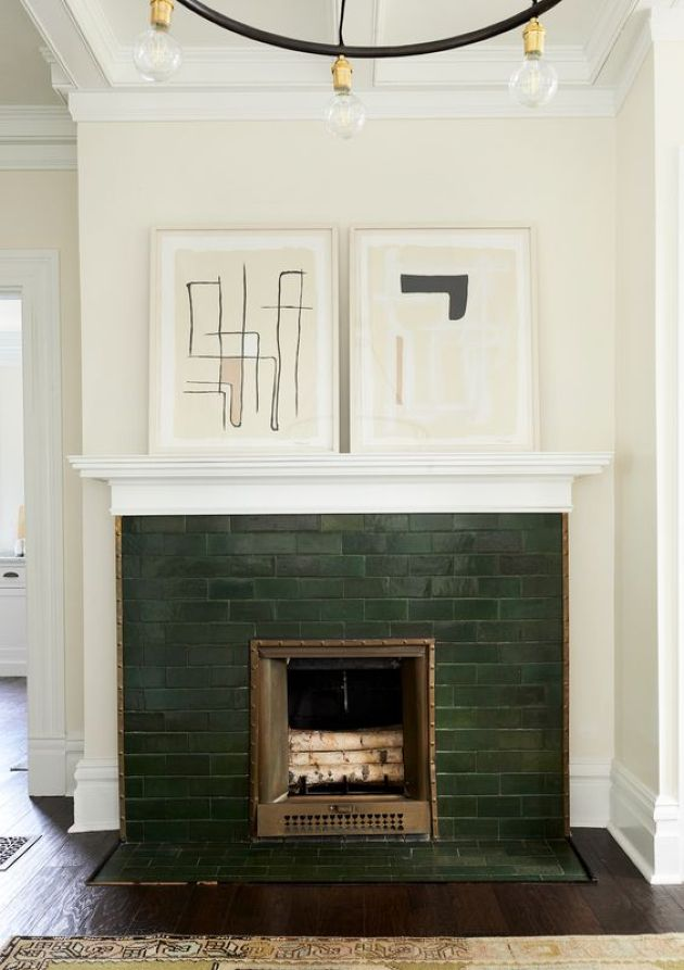 Small Fireplace With Dark Green Tiles And Abstract Artworks