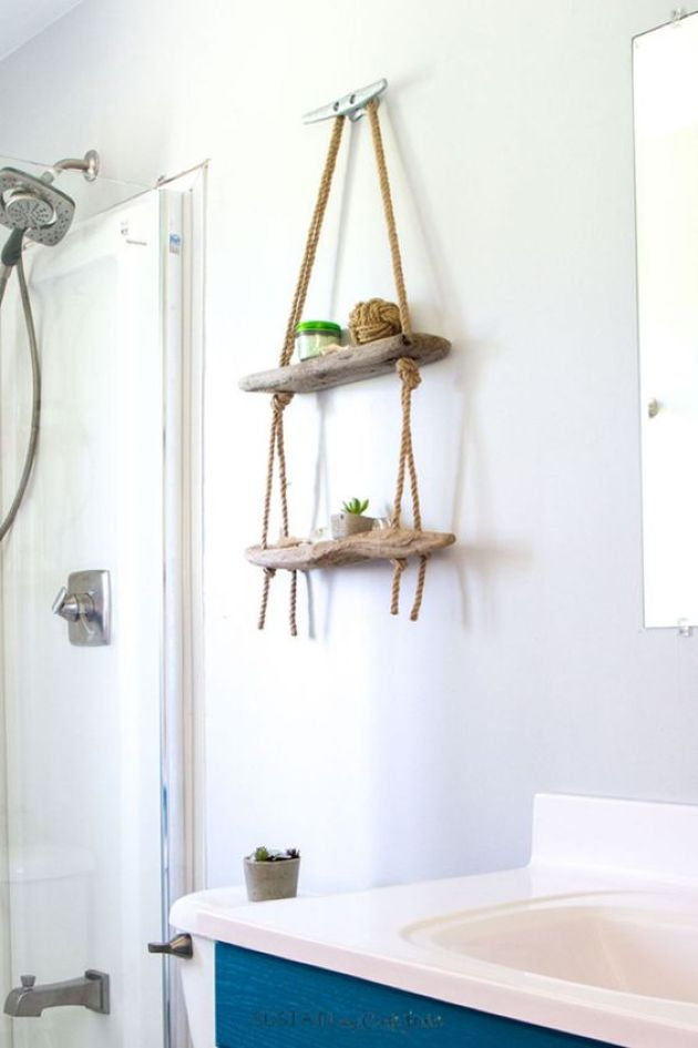 Small Hanging Display Shelf For A Bathroom Made Of Driftwood And Ropes