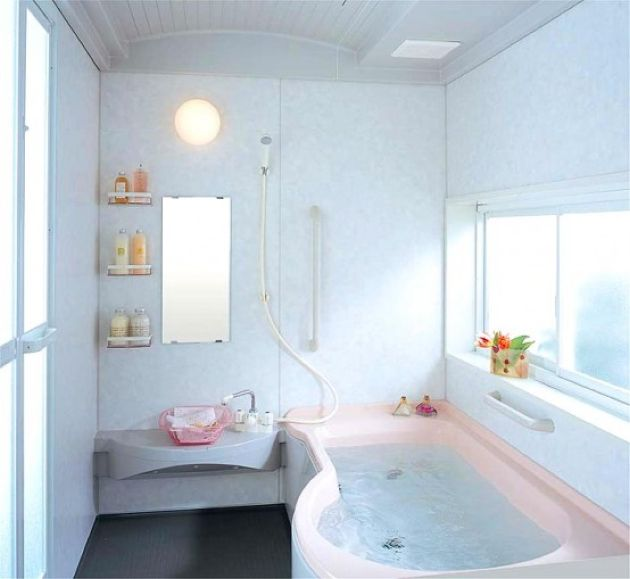 Small Neutral Bathroom Design With A Pink Bathtub