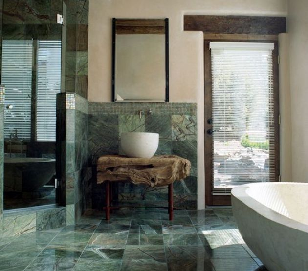 Stunning Natural Bathroom With Green Marble Tiles Plus A Raw Wood Slab Vanity