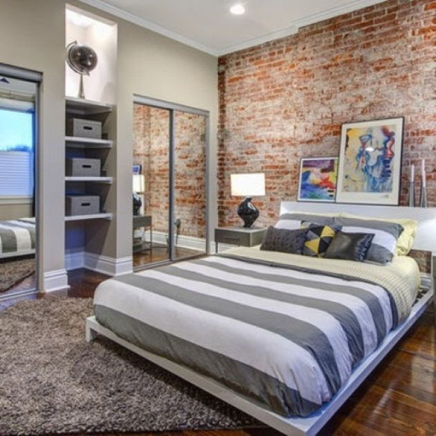 Traditional Bedroom With A Red Brick Statement Wall