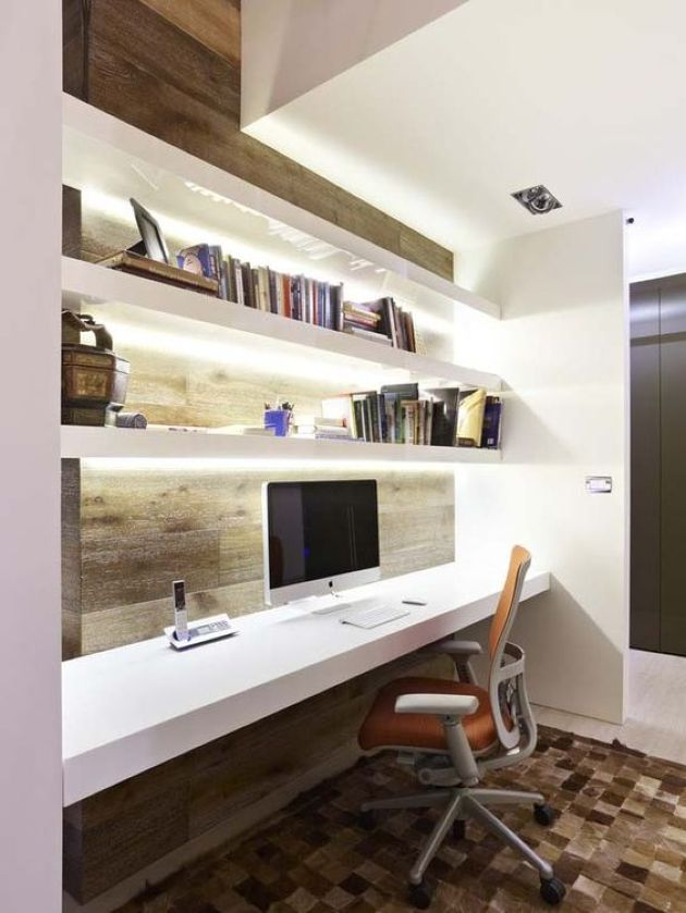 Ultra-Modern Workspace With Lit Up Floating Shelves And A Desk