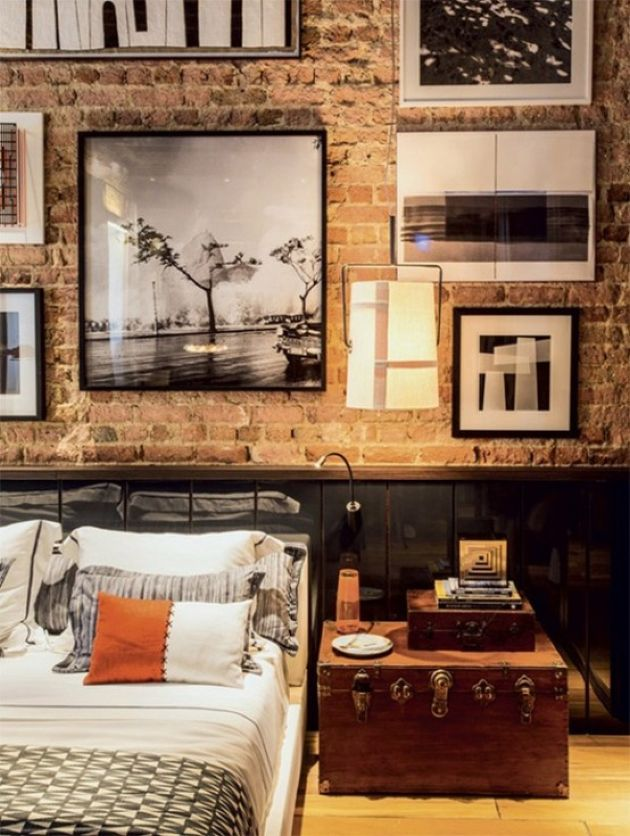 Vintage Industrial Bedroom With A Brick Wall And Sleek Black Panels
