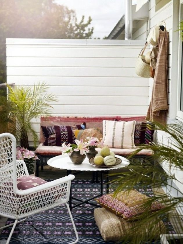 Welcoming Boho Patio With A Mosaic Floor Plus Printed Pillows