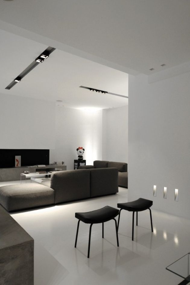 White Minimalist Living Room With A Concrete Console