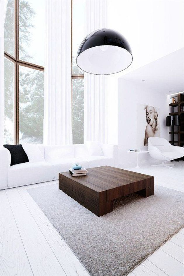 White Minimalist Living Room With Double Height Windows And A White Sofa