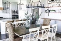 Airy Modern Farmhouse Dining Area With A Wooden Table And Wicker Plus Wooden Chairs And Open Shelving