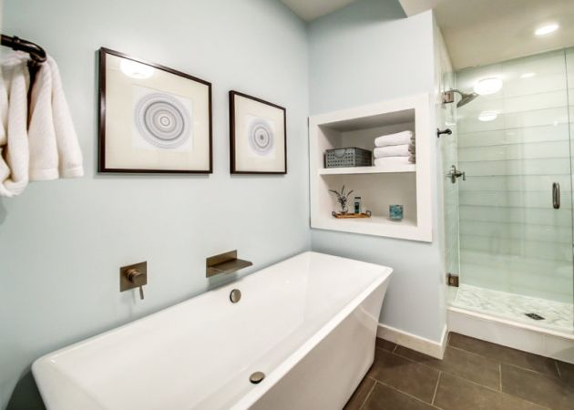 Aqua-Colored Bathroom With Painted Walls And Matching Tiles