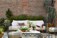 Backyard Patio Design Ideas With Pendant Lights And Pillows