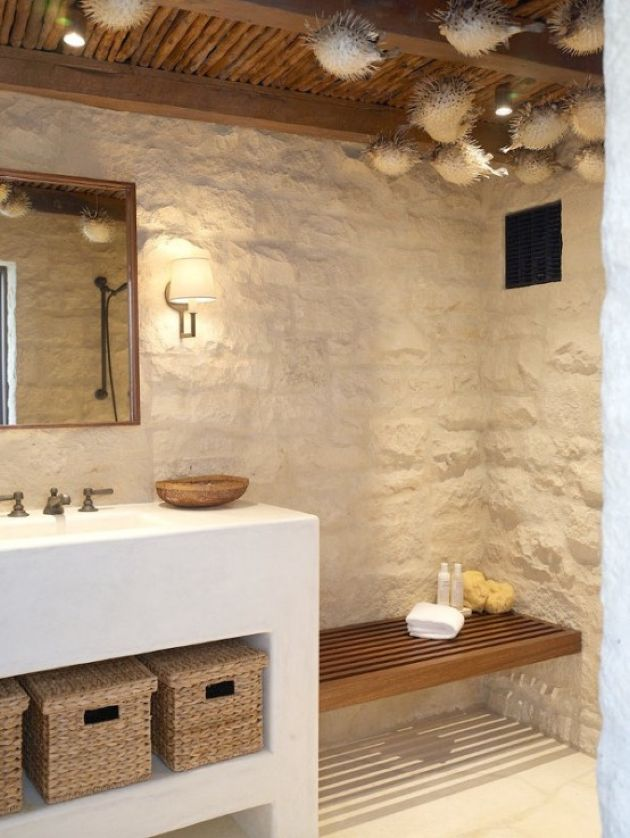 Beach Bathroom With Stone Clad Plus A White Vanity With Baskets For Storage