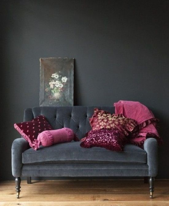 Black Velvet Loveseat With Refined Legs And Fuchsia And Purple Pillows For A Moody Space