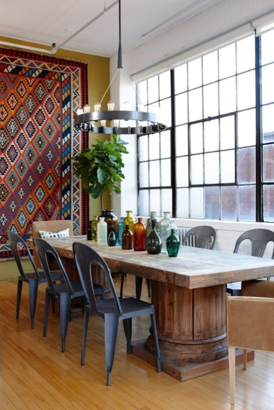 Boho Dining Room With A Wooden Table Plus Metal And Leather Chairs