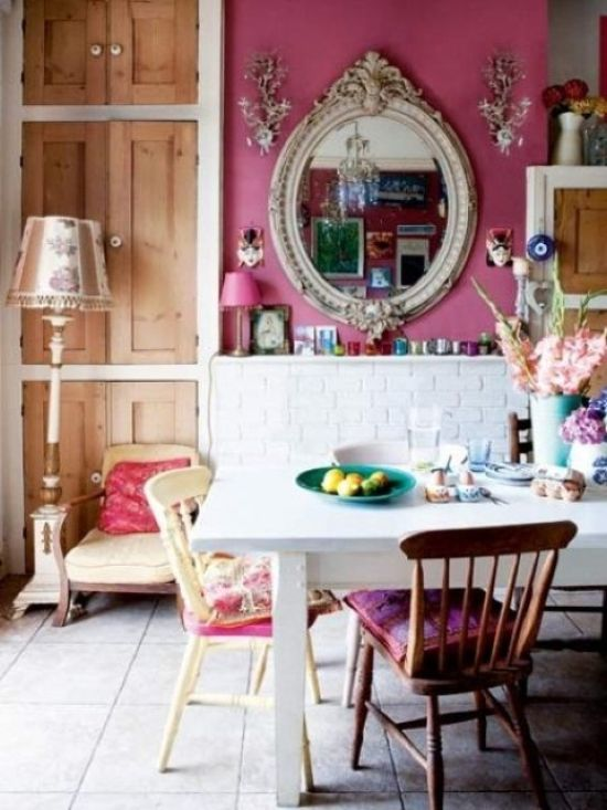 Boho Dining Space With Pink And White Brick Walls And Colorful Mismatching Chairs