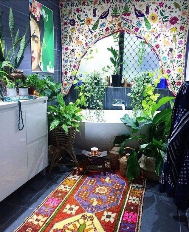 Boho Moroccan Bathroom With A Colorful Curtain And A Brugth Rug Plus Artwork
