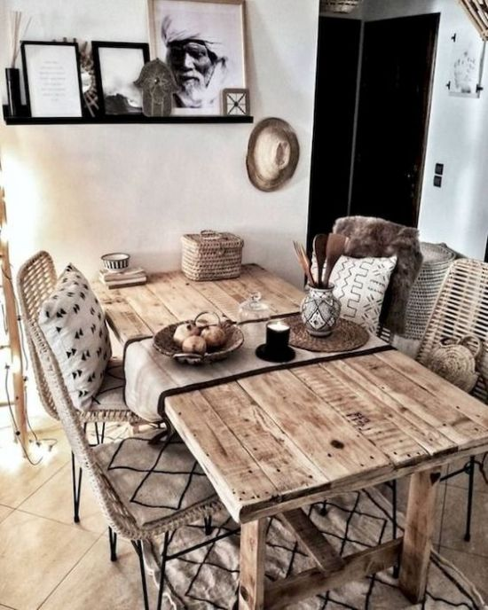 Boho Rustic Dining Space With A Rustic Wooden Table And Wicker Chairs