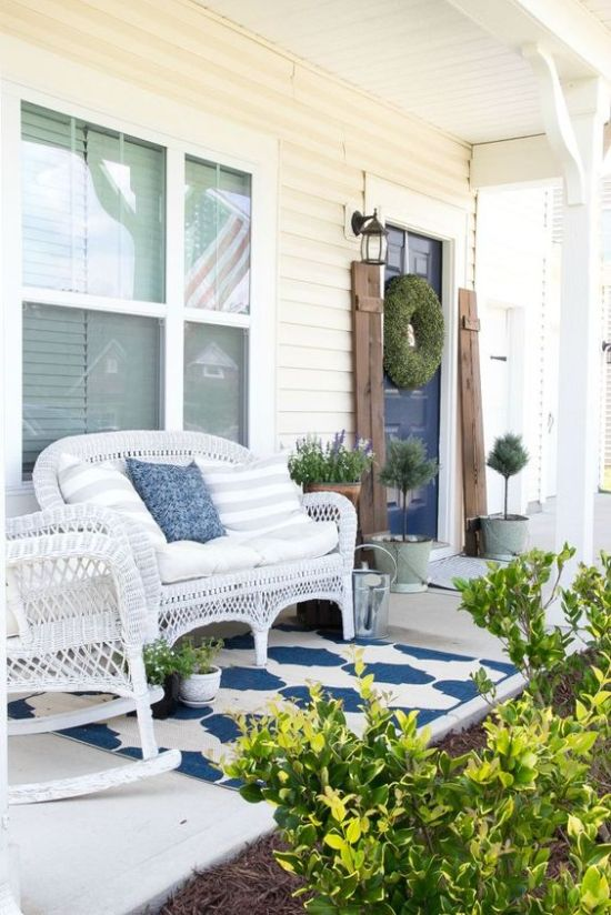 Bright Summer Porch With White Wicker Furniture